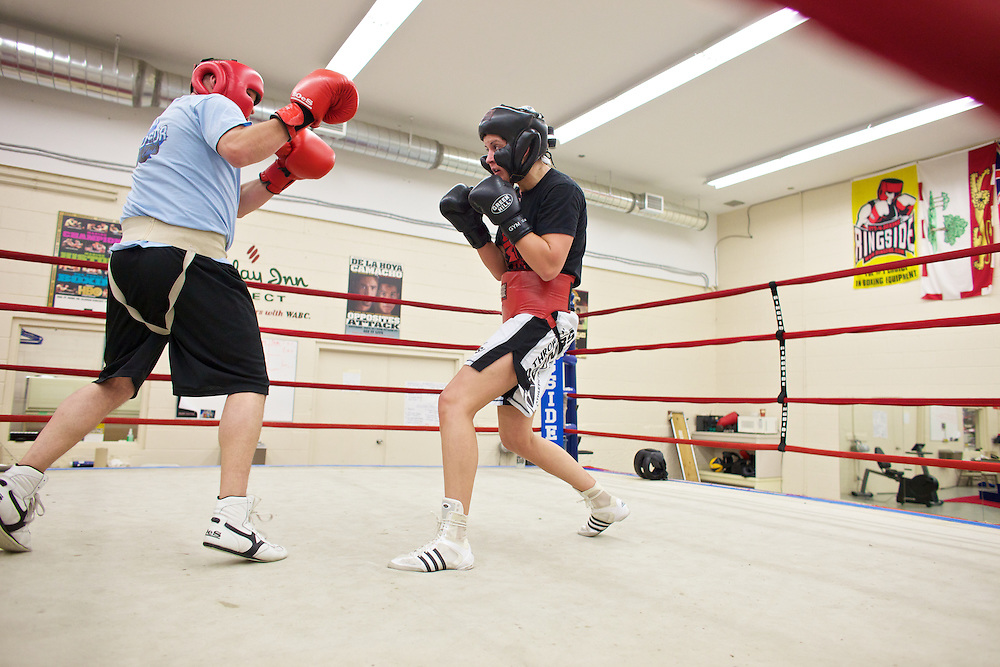 Windsor, Ontario ---10-05-06--- World Welterweight Champion, Mary Spencer, right, spars with a male fighter from her club during a traning session at the Windsor Amateur Boxing Club in Windsor, Ontario, May 6, 2010.<br /> GEOFF ROBINS The Globe and Mail