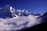A bank of heavy clouds rolls up the Gokyo Valley underneath high Himalayan peaks.