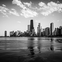 Chicago skyline in black and white with the Hancock building and other popular downtown Chicago city buildings. The John Hancock Center building is one of the world's tallest skyscrapers and is a famous fixture in the Chicago skyline.