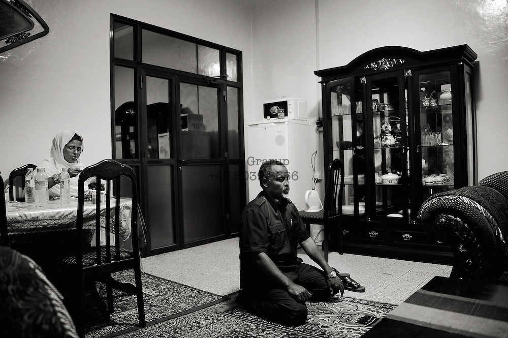 The mayor praying during a lunch break at his home in the Mogadsihu.