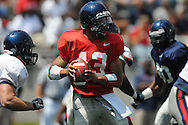 Red team quarterback Raymond Cotton passes in Mississippi's Grove Bowl in Oxford, Miss. on Saturday, April 17, 2010.