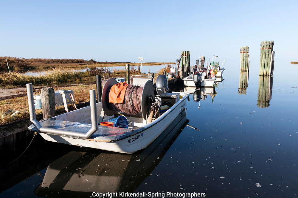NC00739-00...NORTH CAROLINA - Fishing boats docked along the edge of the Pamlico Sound in Rodanthe on the Outer Banks.