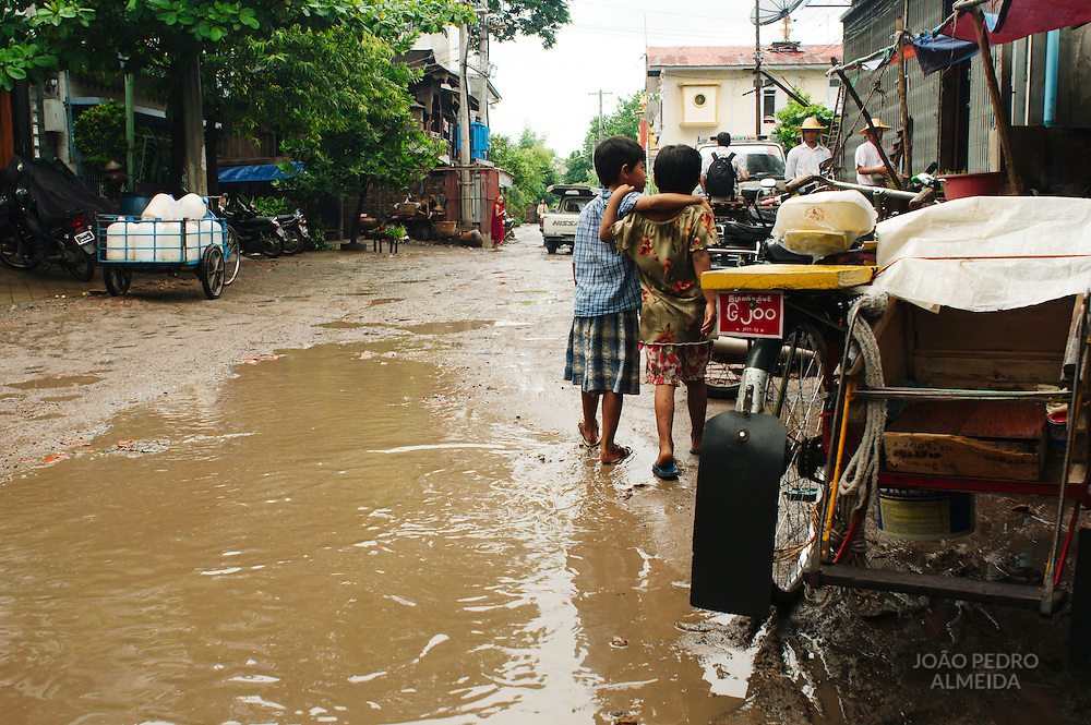 Boys at a muddy street of Mandalay