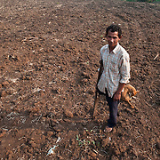 A Cambodian landmine victim is seen in his recently plowed and planted field near Pailin, Cambodia on the Thai border.