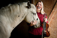 "JEROME A. POLLOS/Press..Diana Clemons will be performing a fundraising concert called ""Life is a Cadenza"" which will benefit her Harmony Ranch Therapuetic Riding Center and the Lake City Playhouse. Clemons uses horses, like Galahad, her 5-year-old Appaloosa stallion, to provide therapy for people with mental and physical disabilities."