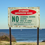 A NO Swimming sign at the entrance to the beach in Deal, New Jersey