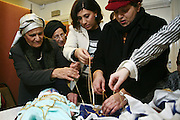 Pidyon Haben is a rite of passage in Judaism that is known as 'the redemption of the first born son'. It takes place when a baby is at least 31 days old, and involves 'buying him back from a Cohen.' Here the baby is draped in gold by the mother, grandmother and family and then bought back from a Cohen for 5 pieces of silver. The baby has to be the first boy who has opened his mother's womb and not have been delivered by a caesarean birth.
