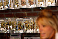 A patient is waited on (not seen) in a medical marijuana center in Denver April 2, 2012.  With Colorado voters set in November to decide whether to defy the federal government and legalize marijuana for recreational use under state law, the enforcement division could play a key role in bringing a black market pot trade out of the shadows.  REUTERS/Rick Wilking (UNITED STATES)