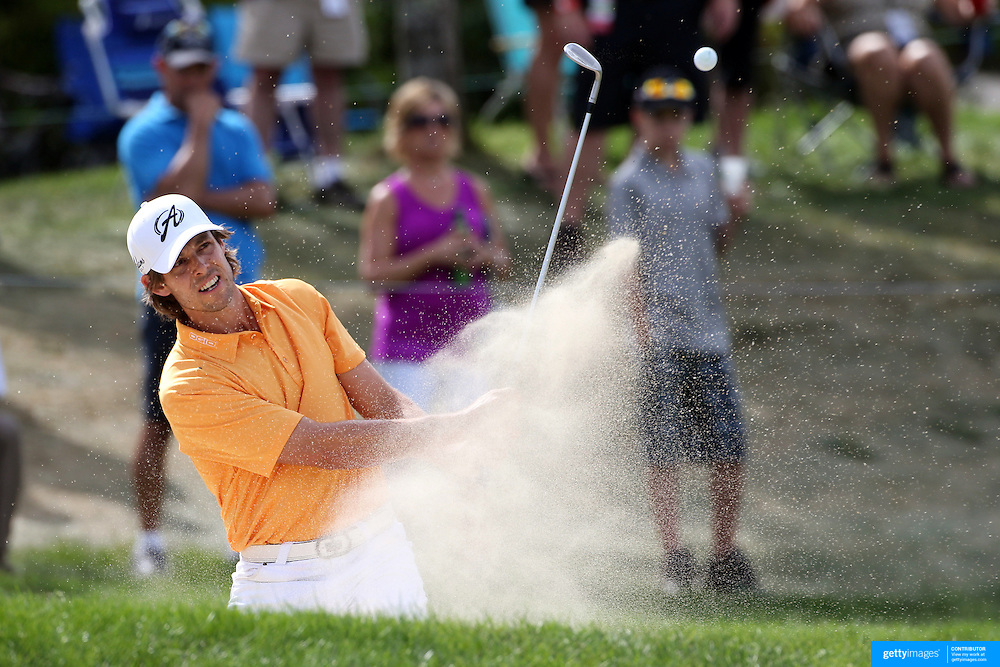 Aaron Baddeley, Australia, chips out of the bunker on the 14th during the final round of the Travelers Championship at the TPC River Highlands, Cromwell, Connecticut, USA. 22nd June 2014. Photo Tim Clayton
