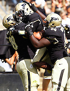 WEST LAFAYETTE, IN - SEPTEMBER 15:  Offensive tackle Trevor Foy #78 of the Purdue Boilermakers, running back Akeem Hunt #11 of the Purdue Boilermakers and offensive linesman Kevin Pamphile #64 of the Purdue Boilermakers celebrate a touchdown against the Eastern Michigan Eagles at Ross-Ade Stadium on September 15, 2012 in West Lafayette, Indiana. (Photo by Michael Hickey/Getty Images)***Local Caption***Trevor Foy; Akeem Hun; Kevin Pamphile