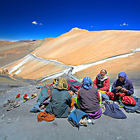 A Group of Ladies relaxing after a hard day's work...<br /> There work was to remove the Ice from the road...<br /> A lot of people living near this route (Manali to Leh Highway) make their living through the repair of this road, which goes on throught out the 7-8 months when it remains open.<br /> Taken at Tanglang-La, elevation 17,582 feet (5,359 m).