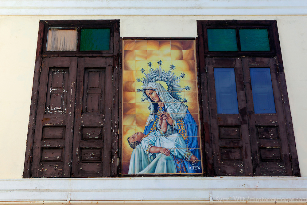 USA, Puerto Rico, San Juan. Tile facade of Madonna and child between windows.