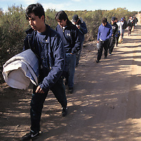 A large group of undocumented immigrants are caught near the US/Mexico border and taken to a detention facility in California.