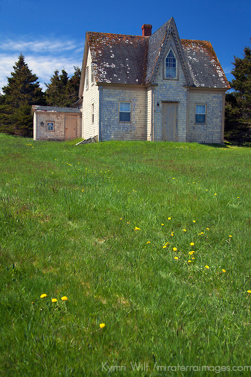 North America, Canda, Nova Scotia, Guysborough County. Yellow weathered home of Nova Scotia.