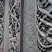 At Urnes Stave Church, Norway, Viking Age animal art meets Christian architecture..Urnes stavkirke (or stavkyrkje), the oldest Stave Church in Norway, stands at Ornes farm on Lustrafjord in Luster municipality, Sogn og Fjordane county, Norway. The church was built around 1135 AD and links Christian architecture with animal-ornamentation of the Viking Age. In 1979, Urnes Stave Church was listed as a World Heritage Site by UNESCO. Fortidsminneforeningen (Society for the Preservation of Norwegian Ancient Monuments) has owned it since 1881.