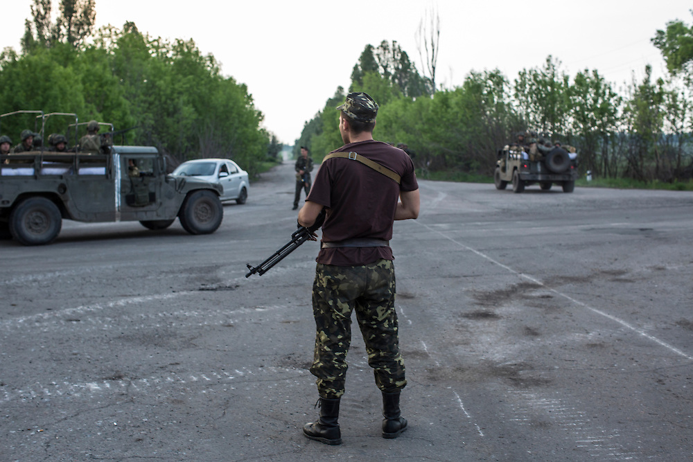 NOVATROIZK, UKRAINE - MAY 14: Ukrainian soldiers guard a checkpoint on May 14, 2014 in Novatroizk, Ukraine. Pro-Russian militants ambushed Ukrainian troops nearby the day before, killing seven and wounding another eight in the most deady attack yet on Ukrainian forces. (Photo by Brendan Hoffman/Getty Images) *** Local Caption ***