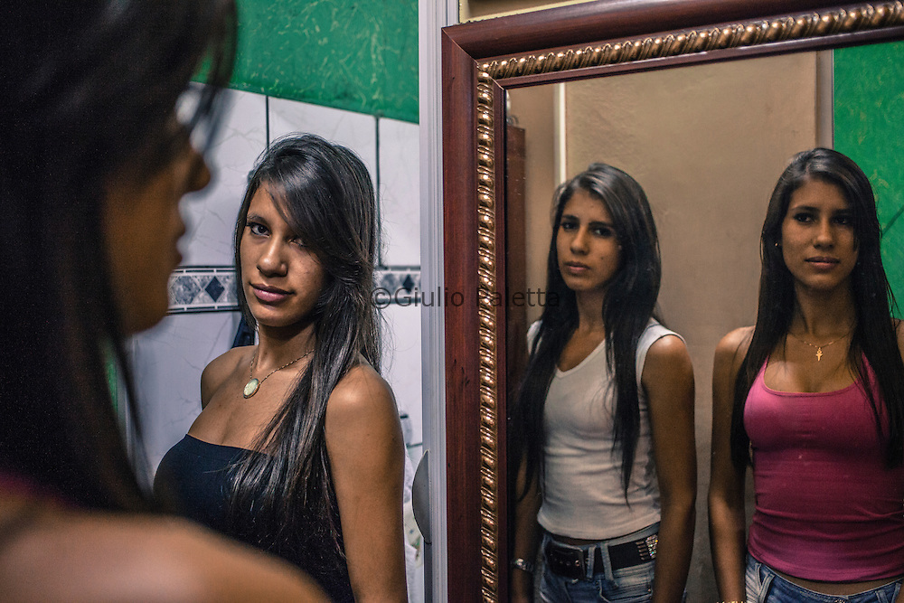 "Pedro Juan Caballero - Ponta Porã, MS, border Paraguay - Brazil. ""Las tres Marias"". That is how Maria Leticia, Maria Lorena and Maria Larissa are called among their friends at school. Three Paraguayan twins, Brazilian-born. 20 years old. They live in the Paraguayan side but they study in the Brazilian one.  They speak perfect portuguese but they feel Paraguayans. Between them they speak only spanish"