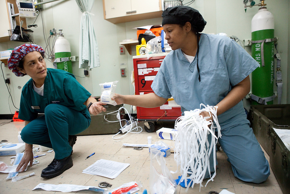 Imelda Donohue, left, and Dee Harrison, nurses on board the USNS Comfort, a naval hospital ship, organize surgical supplies. The Comfort is on a mission to help survivors of the earthquake in Haiti on Monday, January 18, 2010 in the Atlantic Ocean off the coast of the United States.