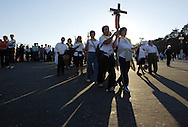 Pilgrims hold a cross as they arrive at the Catholic Fatima shrine in central Portugal 12 October 2006. Thousands of pilgrims converged on Fatima to celebrate the anniversary of the first apparition of the Virgin Mary to three shepherd children on 13 May 1917.PHOTO PAULO CUNHA/4SEE