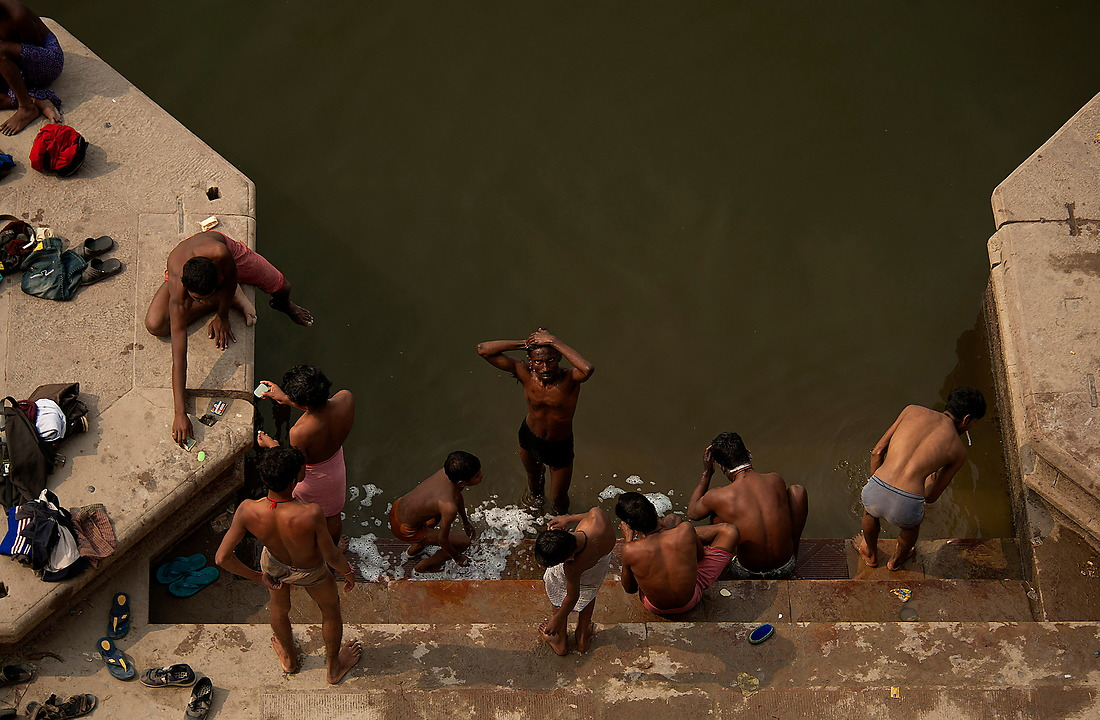 A group of young boys bathe in the rives Ganges from the banks of Varanasi, India on February 1, 2013. — © Jeremy Lock/