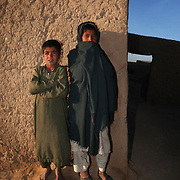 020101-N-2383B-515.HELMAND PROVINCE, Afghanistan (January 01, 2002) -- Children of a nearby village watch as U.S. Marines with the 26th Marine Expeditionary Unit (Special Operations Capable),  conduct a Cordon and Search Raid at a suspected al Quaeda hideout in the Helmand Province of Afghanistan.  U.S. Marines are in Afghanistan operating in support of Operation Enduring Freedom.  U.S. Navy photo by Chief Photographer's Mate Johnny Bivera, Fleet Combat Camera Atlantic (RELEASED).