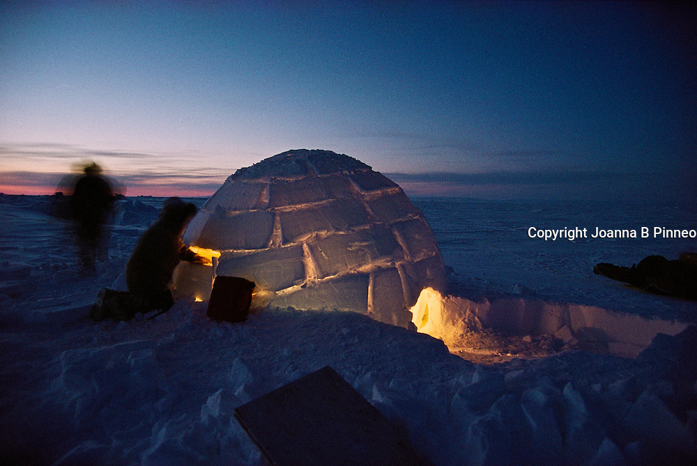Building the igloo for the night on a native Polar bear hunt out from Igloolik.