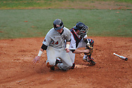 Arkansas State's Jordan Castaldo is tagged out at home by Ole Miss' Taylor Hightower (13) at Oxford University Stadium in Oxford, Miss. on Wednesday, February 23, 2011.