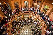 """Protestors fill the rotunda inside the Michigan State Capital during a protest against Emergency Financial Manager legislation at the Michigan State Capital in Lansing, MI, Tuesday, March 8, 2011. According to the law, which has already been approved in the House, the governor will be able to declare """"financial emergency"""" in towns or school districts and appoint someone to fire local elected officials, break contracts, seize and sell assets, and eliminate services. Under the law whole cities or school districts could be eliminated without any public participation or oversight. (Jeffrey Sauger)"""