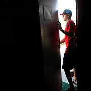 The A's Cory Pallutch leaves the Clarinda clubhouse.  photo by David Peterson