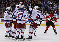 Mar 25, 2010; Newark, NJ, USA; The New York Rangers celebrate a goal by New York Rangers center Brandon Dubinsky (17) during the second period at the Prudential Center.