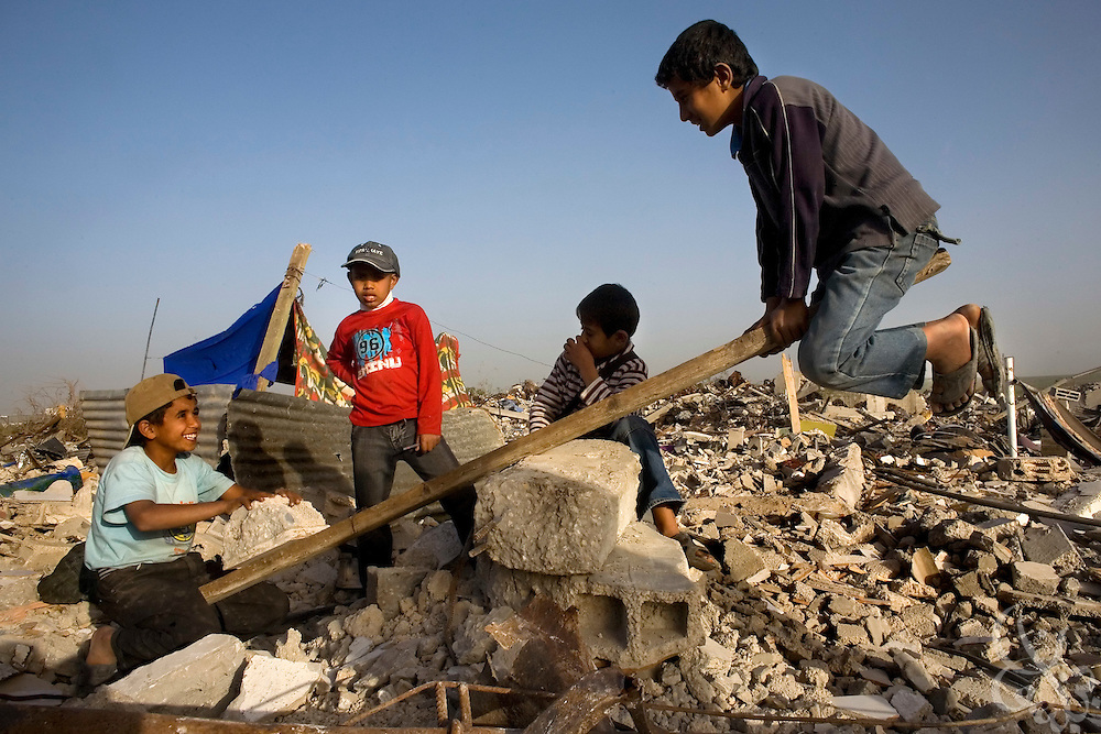 Palestinian children play on a homemade see-saw, constructed from the rubble of their destroyed home January 25, 2009 in the Izbet Abid Rabbo district of Gaza. A week after the end of Israel's 22 day operation against HAMAS in Gaza, Palestinians are struggling to come to terms with their losses and adapt to the massive changes the operation has made on their everyday lives.