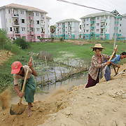 Burmese children dig drainage ditches near the new capital of Naypyidaw.