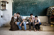 Syria. Syrians are seen in a undisclosed location where Syrians families are taking cover from regime shelling in Aleppo's province.  ALESSIO ROMENZI