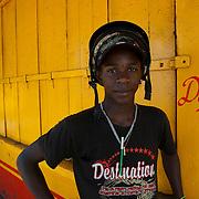 Mauritius. Cedric, outside a store in Solitude.