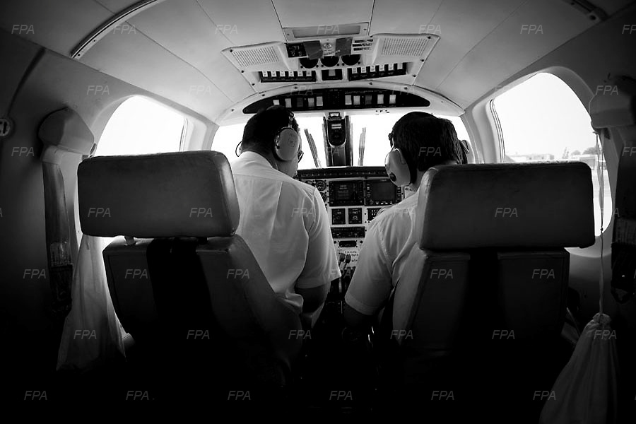 Pilots go through a systems check before flying out for a surveillance of surrounding areas. Image © Angelos Giotopoulos/Falcon Photo Agency