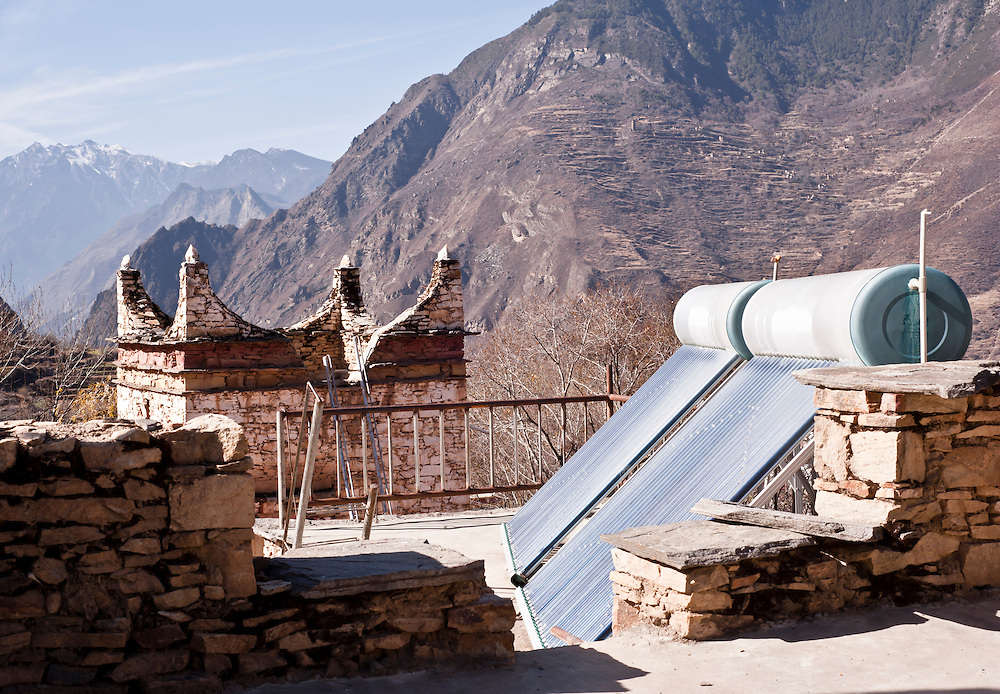 Solar water Heating System on the roof of a traditional tibetan house, Sichuan province, China