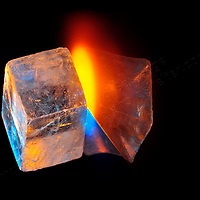 A selenite cube in transition through space and time