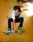 Professional snowboarder Danny Kass is a two-time Olympic silver medalist in the half pipe and runs his own apparel company called Grenade. He likes to relax by skateboarding in their back room they also use as storage.