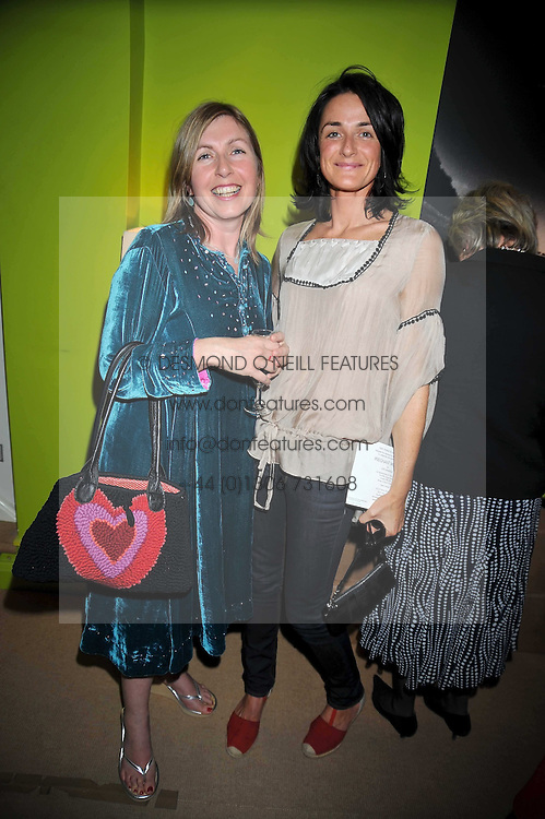 Left to right, TABITHA ROBERTSON and LARA STAPLETON at a party to celebrate the publication of Joth Shakerley's book 'Pregnant Women' held at 598a Kings Road, London SW6 on 20th May 2009.