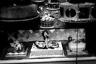 Erotic cakes for sale in Adriatico Street bakery window.  This area of Ermita is experiencing a resurrgence of street prostitution after a Christian mayor had closed down most of the girly bars in the 1990's, Manila, Philippines.