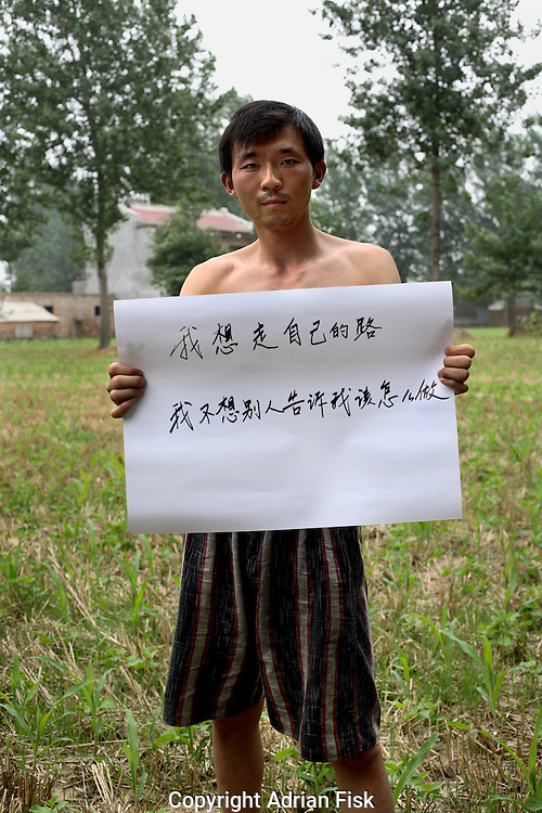 Jiang Min - 24 Yrs.<br /> Farmer.<br /> Henan Province.<br /> <br /> 'I want to walk my own path, I don't want other people telling me what to do'..