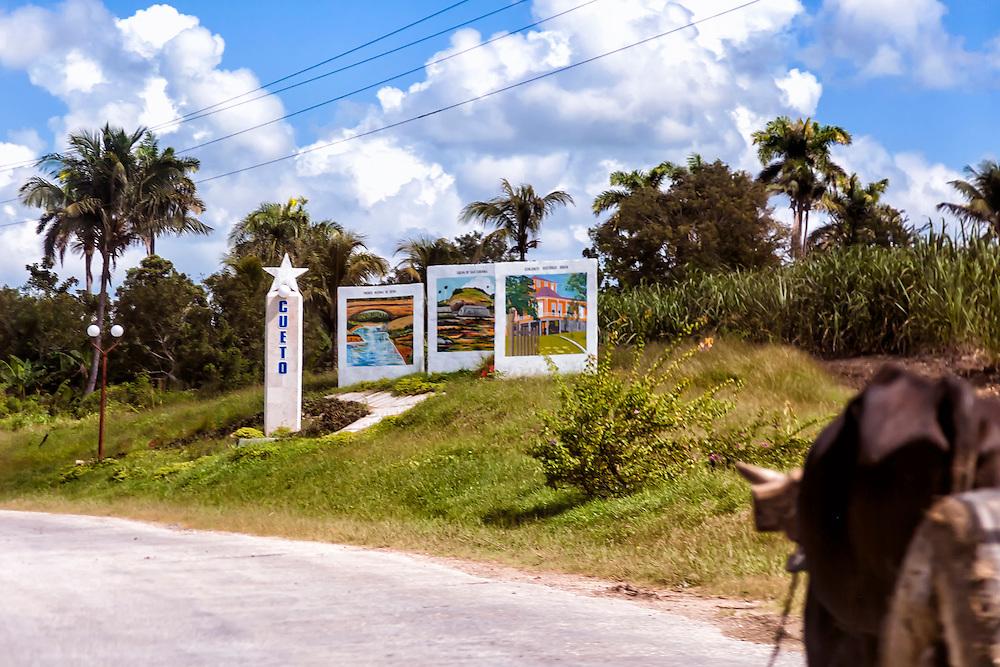 Town entry sign in Cueto, Holguin, Cuba.