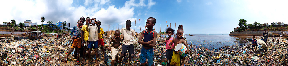 Bilal, Amadu and their friends play by the sea with Olympus digital cameras, Kroo Bay, Freetown, Sierra Leone.