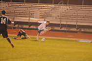 Oxford High's Edward Terry (10) vs. Starkville in MHSAA playoff high school soccer action in Oxford, Miss. on Tuesday, January 29, 2013. Oxford won 3-1 to advance to the state championship game.
