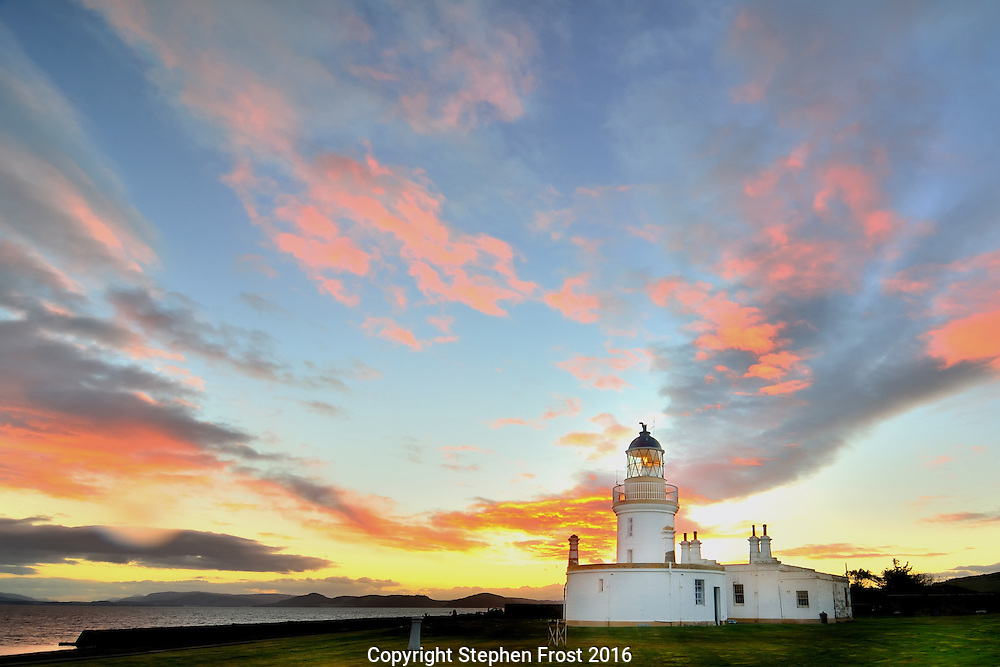 Lighthouse at Chanonry Point, Moray Firth, Scotland, at dusk.