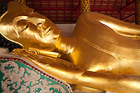 Reclining Buddha at Wat Pongsanuk- a sacred temple in Lampang. It is said that this temple was erected in 1888 by Kru Ba Anochidhamma Jindamuni. The temple is situated at the center of the Pongsanuk community, made up of 151 homes and 838 residents. The temple architecture is mixed with a Burmese temple floor plan consisting of a three tiered roof in the centre and phayathat - small upwards of three tier roofs in the same size decorated on the centre, Viharn Phra Chao Pun Ong, Pongsanuk Temple is the unique jewel of Mahayan Buddhism Architecture of Lanna Kingdom.  Following its restoration Wat Ponsanuk received a merit award from UNESCO for its efforts in restoration.