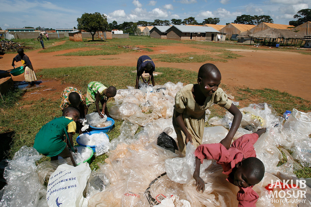 October 7, 2006 - Night commuter children clean plastic bags used in making handbags at the Charity for Peace compound where children come for safety from possible abductions by the LRA in Gulu in north Uganda. Gulu is the main base for the Uganda Peoples Defense Force fighting the insurgent Joseph Kony's Lord's Resistance Army. Kony's LRA movement has been fighting for the past 20 years to force the East African country to be ruled according to the Christian Ten Commandments. Over 2 million people, mostly of the Acholi tribe, have moved or were forced to move from their villages to camps close to the towns of Gulu, Lira, and Kitgum where they are watched over by the Ugandan Army. The LRA rebels have abducted thousands of children and have forced them to fight against the Ugandan Army and the Acholi people. Current peace talks between Kony's LRA and the Ugandan government held in Juba, southern Sudan, offer a glimpse of hope to ending this ongoing conflict..(Photo by Jakub Mosur/Polaris)<br />