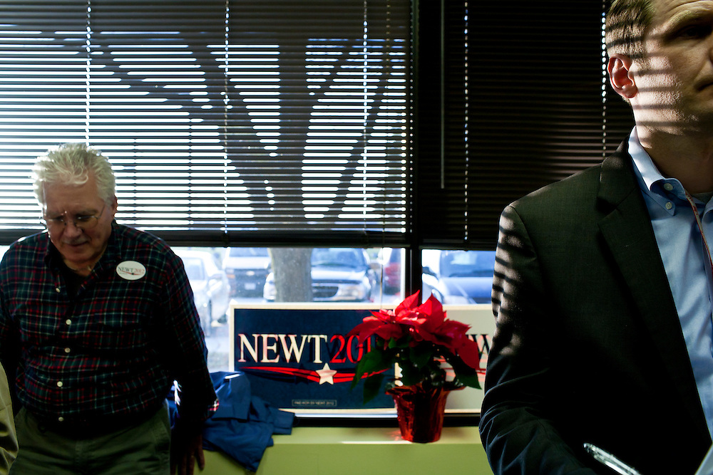 Audience members listen as Republican presidential candidate Newt Gingrich speaks at the opening of a new campaign office on Saturday, December 10, 2011 in Urbandale, IA.