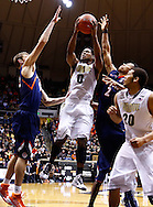 WEST LAFAYETTE, IN - JANUARY 02: Terone Johnson #0 of the Purdue Boilermakers shoots the ball against Tyler Griffey #42 of the Illinois Fighting Illini and Joseph Bertrand #2 of the Illinois Fighting Illini at Mackey Arena on January 2, 2013 in West Lafayette, Indiana. Purdue defeated Illinois 68-61. (Photo by Michael Hickey/Getty Images) *** Local Caption *** Terone Johnson; Tyler Griffey; Joseph Bertrand