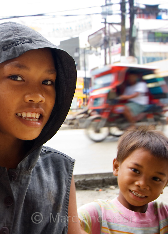 Homeless children on a street, Tagbilaran, Bohol, Philippines..